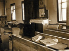 "Ark, pews, lecterns, and prayer books in Bershad synagogue, 1991 (courtesy of Rita Ostrovskaya, ""Jews in Ukraine, Shtetls"")"